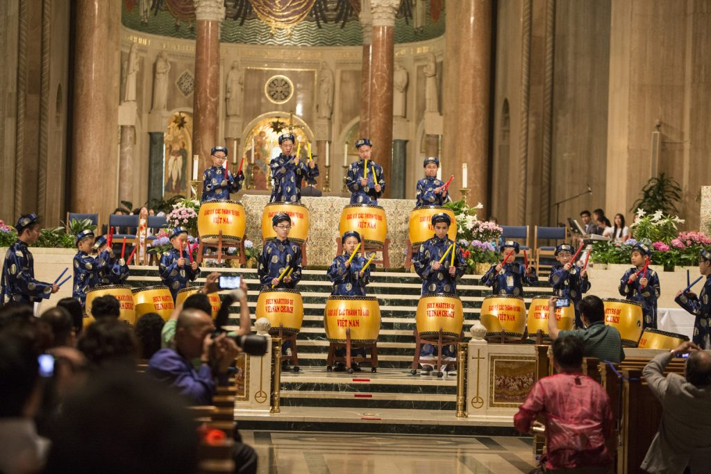 Youths from The Holy Martyrs Catholic Church Arlington, VA., perform traditional music during an Asian pilgrimage at Washington basilica