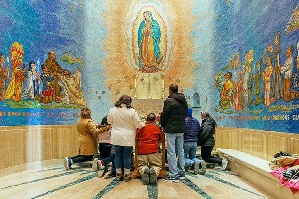 Family praying in Our Lady of Guadalupe Chapel