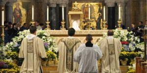 Kneeling before altar at Holy Thursday Mass