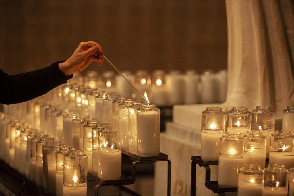 basilica visitor lights candle