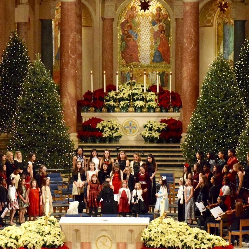 Children's choir sings at basilica christmas eve