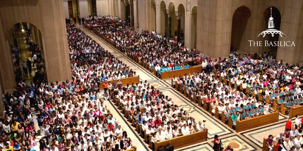 Why do nearly one million people visit the Basilica each year?