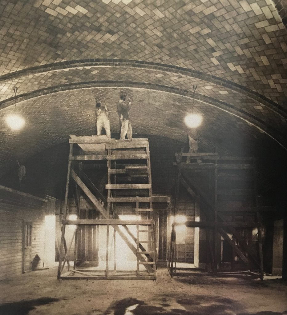 Workers perform construction for the Crypt Church in its early stages.