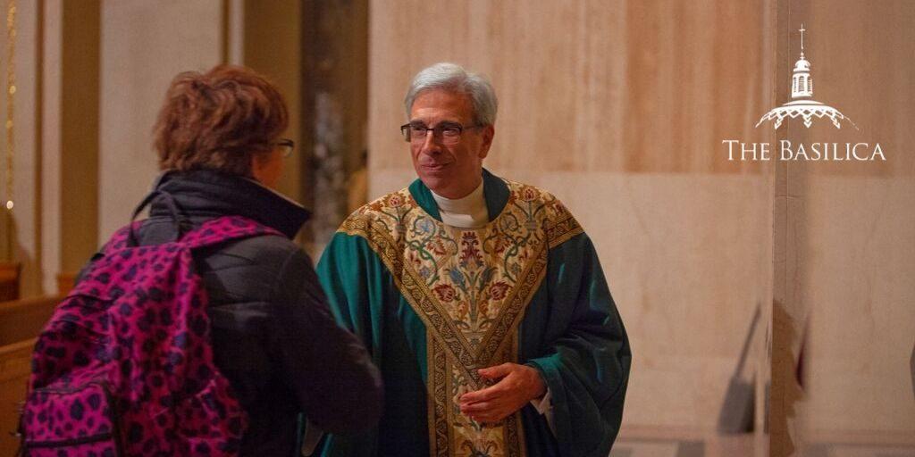 Monsignor Vito handshake banner