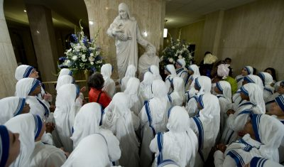 Missionaries of Charity Surround Statue