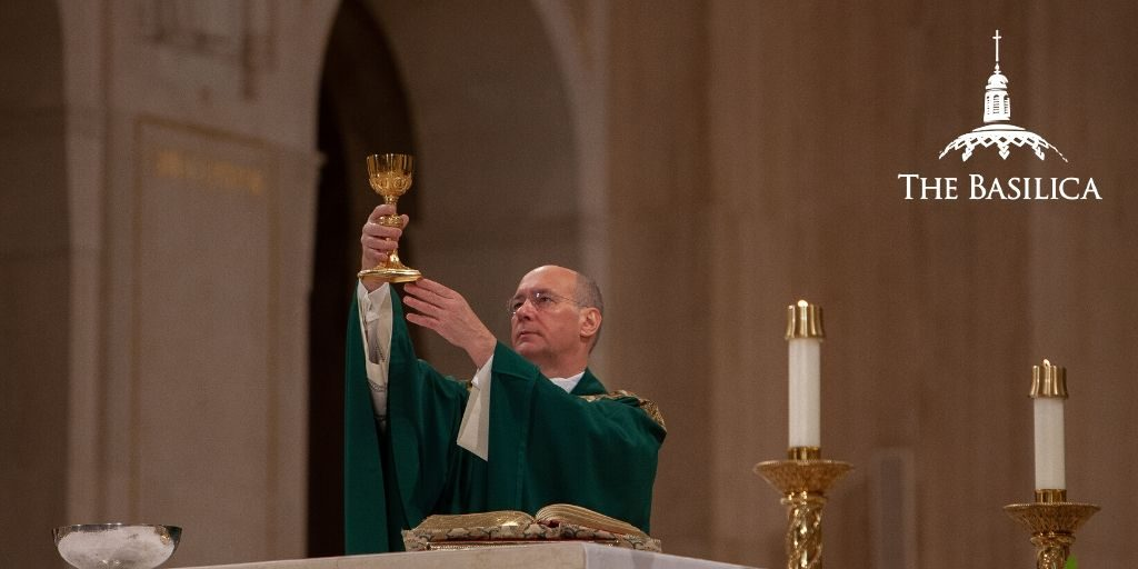 Msgr. Rossi performing sacraments