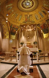 Pope Benedict XVI prays in the Blessed Sacrament Chapel during his visit to the Basilica